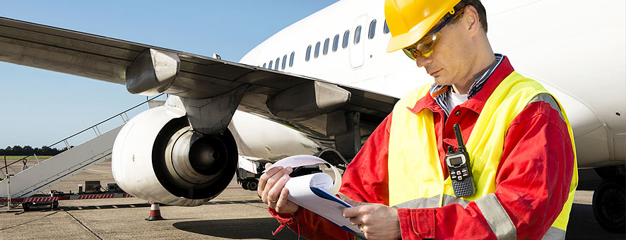 Man conducts manual inspection on an airplane